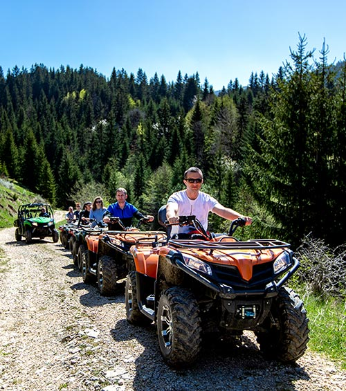 Group having fun riding ATVs on a wilderness trail